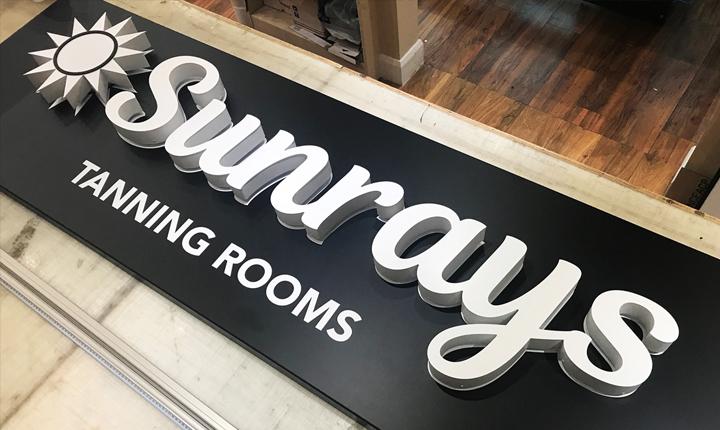 Sunrays shop signage